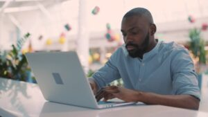 black-person-using-computer2-e1588087139699.jpg